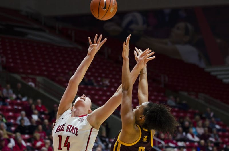 Senior center Renee Bennett reaches for the rebound during the game against Central Michigan University on Feb. 25 at Worthen Arena. Ball State won the game 81-73. Emma Rogers // DN