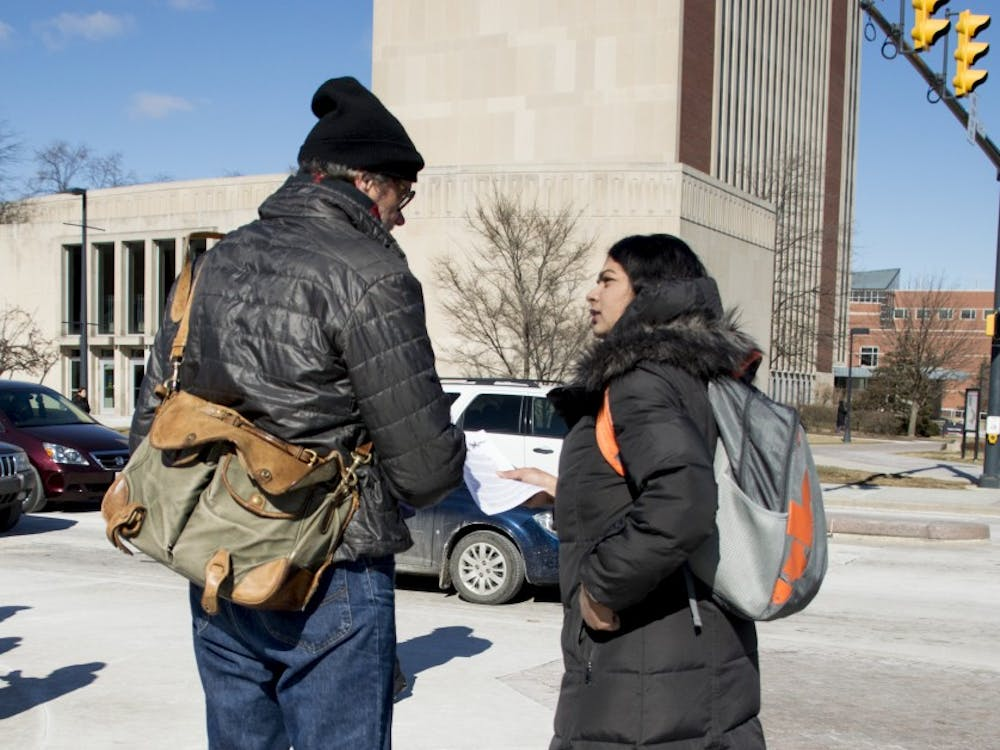 Muncie locals and Ball State students gathered at the Scramble Light on Feb. 13 to protest fossil fuels and pressure the university to divest any stocks that it may hold in fossil fuels.