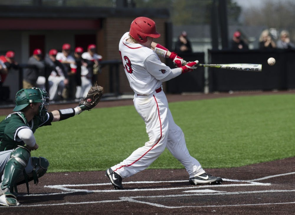Sophomore catcher Griffin Hulecki hits the ball during the game against Ohio University on April 2 at the First Merchants Ballpark Complex. Ball State lost 10-0, bringing the Cardinals losing streak to eight games in a row. Emma Rogers // DN