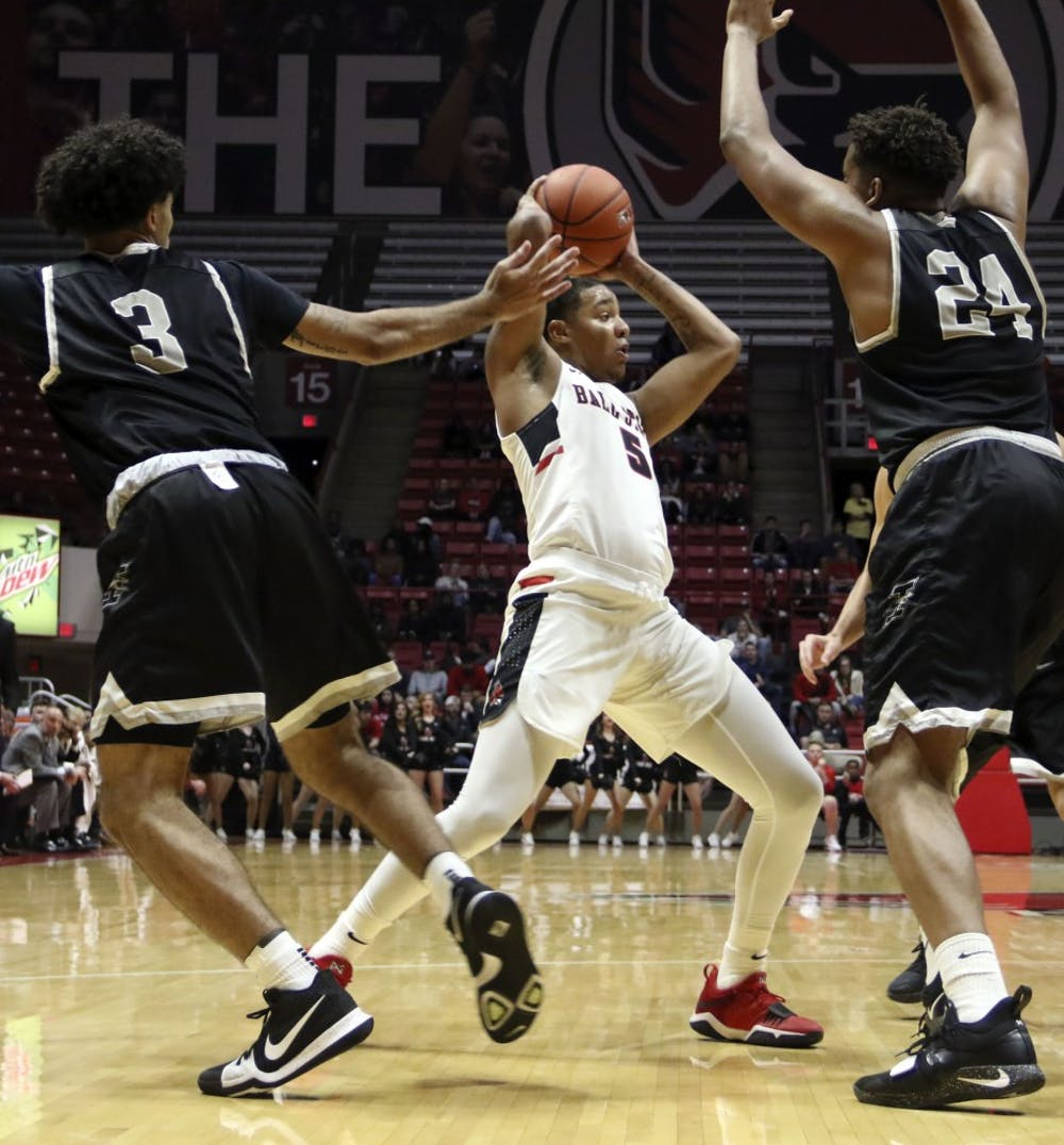 <p>Ball State sophomore guard Ishmael El-Amin tries to find an open teammate while being guarded by the University of Indianapolis' Marcus Latham (3) and Radwan Bakkali (24) during the Cardinals' exhibition game against the Greyhounds Nov. 2, 2018, in John E. Worthen Arena. Ball State won 92-76.<strong> Paige Grider, DN</strong></p>