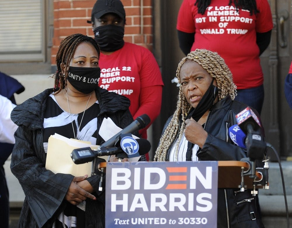 Crystal Williams-Coleman, President the Guardian Civic League, right, talks to reporters during a press conference, Friday, Oct. 9, 2020, in Philadelphia. Public servants, firefighters, paramedics, emergency responders and a diverse group of law enforcement professionals denounced the Fraternal Order of Police and Local 22 for not listening to the concerns of the dues paying union members when endorsing President Donald J. Trump for re-election. (AP Photo/Michael Perez)