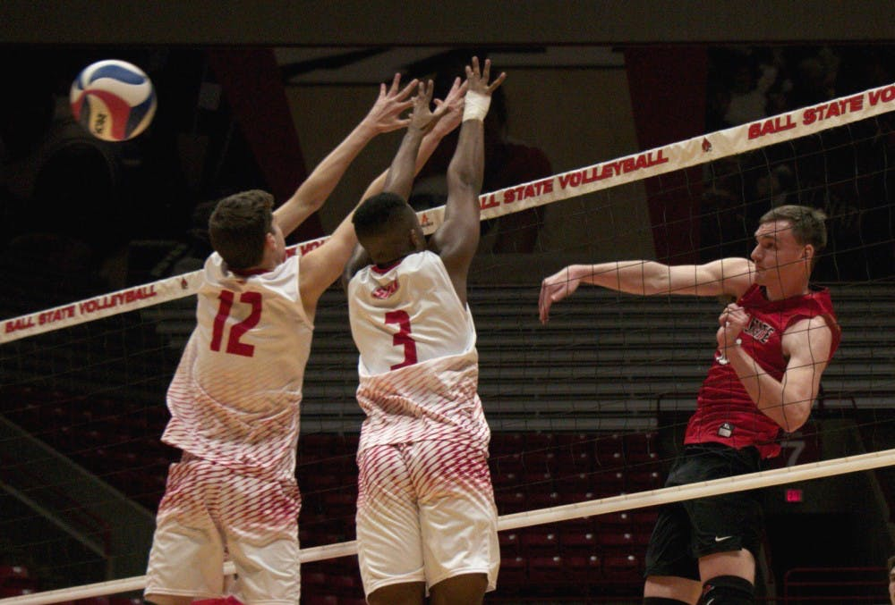 <p>Ball State senior Matt Walsh jumps to spike the ball to score a point during the fourth period against Sacred Heart on Jan. 19. The Cardinals won 3-2. <strong>Carlee Ellison, DN</strong></p>