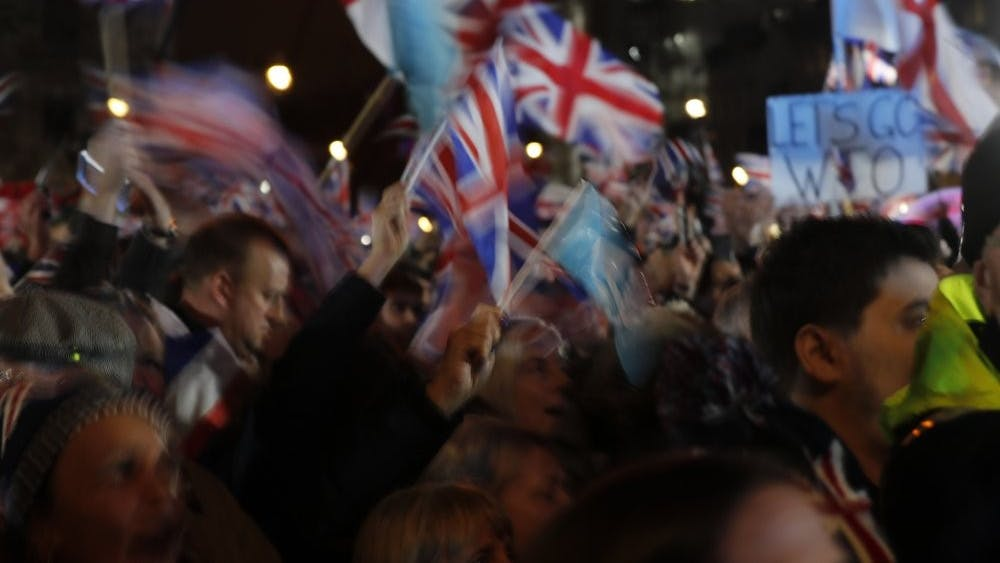 Brexit supporters react during a rally in London, Friday, Jan. 31, 2020. The U.K. is scheduled to leave the EU at 23:00 GMT Friday, the first nation in the bloc to do so. (AP Photo/Frank Augstein)