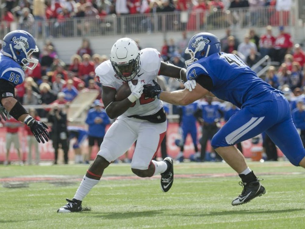 Senior running back Jahwan Edwards attempts to run past Indiana State players during the game on Sept. 13 at Scheumann Stadium. DN PHOTO BREANNA DAUGHERTY