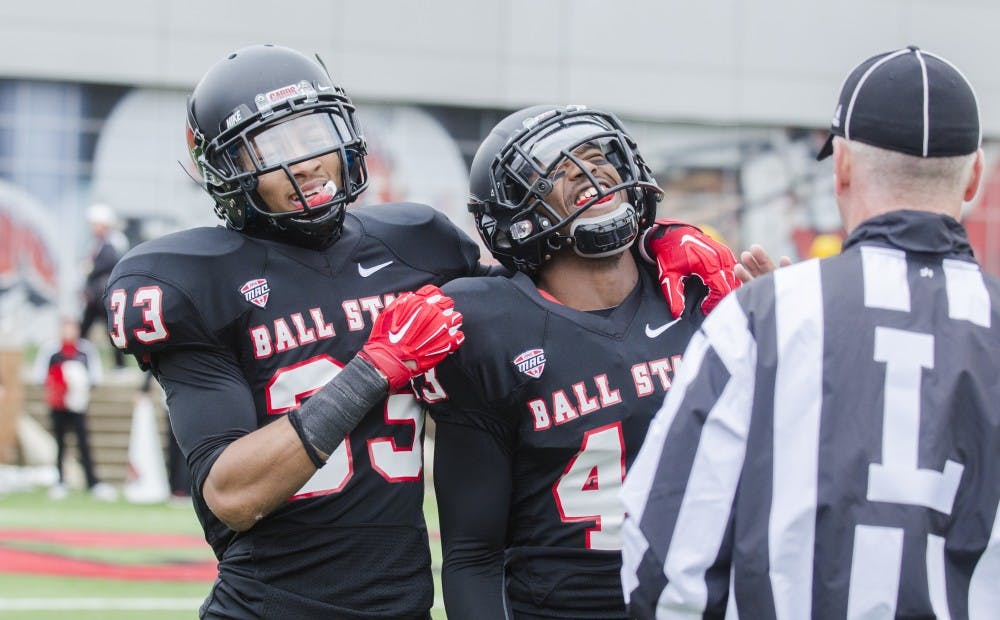 Freshman safety Dedrick Cromartie and redshirt sophomore cornerback Tyree Holder react to interception being ruled at an incomplete pass during the game against Eastern Michigan on Nov. 22 at Scheumann Stadium. DN PHOTO BREANNA DAUGHERTY