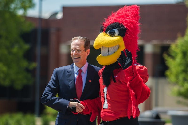 Geoffrey S. Mearns meets Charlie Cardinal during a tour of campus on first day as Ball State's 17th president. Reagan Allen // DN