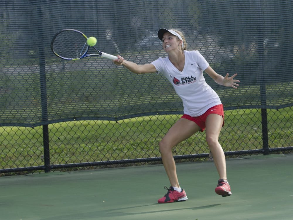 Junior Courtney Earnest reaches for the ball during her singles match against Butler for the Fall Dual on Sept. 20 at the Cardinal Creek Tennis Center. DN PHOTO BREANNA DAUGHERTY