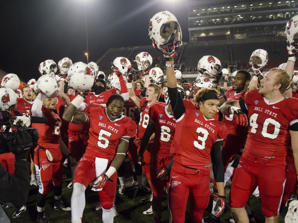 The football team celebrates after a victory during last years