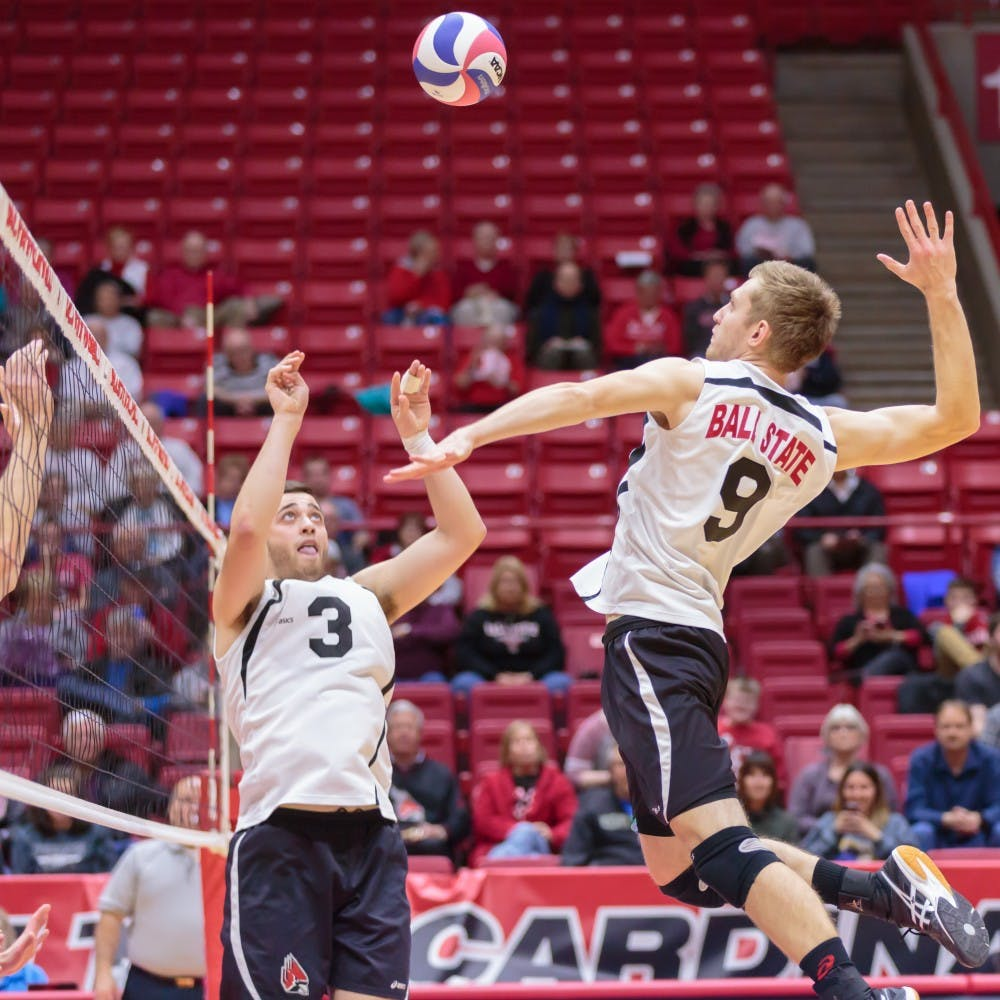 Senior setter Connor Gross sets the ball up for   sophomore middle attacker Parker Swartz during the game against Fort Wayne on Feb. 7 in Worthen Arena. The Cardinals won 3-0 against the Mastodons. Kyle Crawford // DN