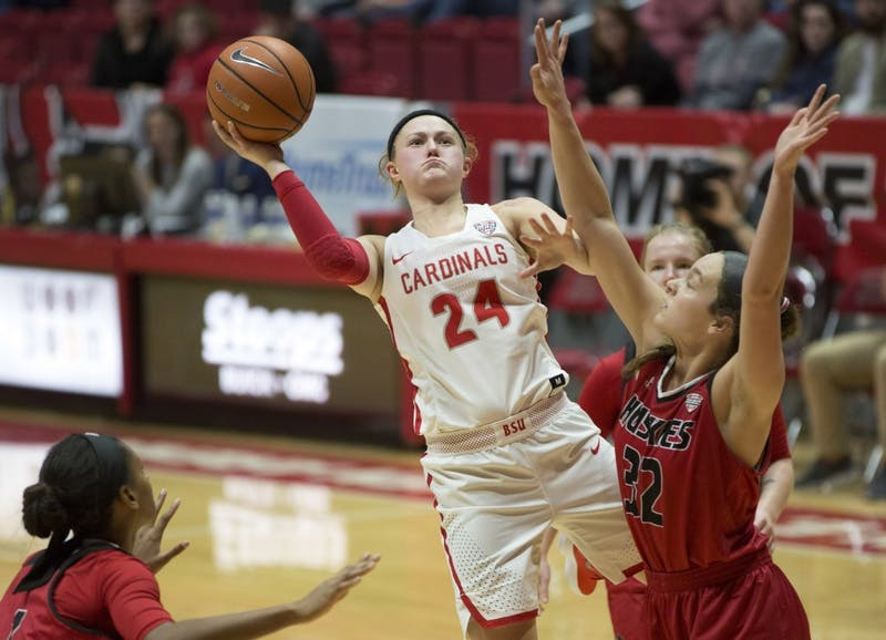 Junior guard Jasmin Samz attempts a shot while being guarded by Northern Illinois' Errin Hodges, left, and Abby Woollacott during the Cardinals' game against the Huskies Jan. 27 in John E. Worthen Arena. Eric Pritchett, DN File