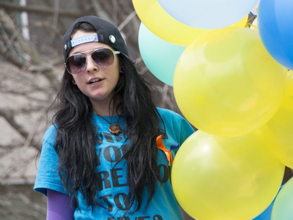Carmen Diaz, a senior social work major, speaks during the Out of the Darkness Walk on April 6. The walk was a part of the Alive Campaign. DN PHOTO TAYLOR IRBY