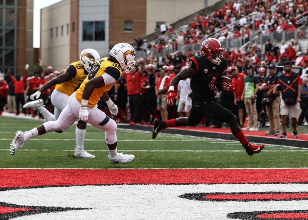 <p>Junior running back Malik Dunner scores a touchdown during the game against Kent State Saturday, Sept 28, 2018, at Scheumann Stadium. Dunner scored the first touchdown of the game. Rebecca Slezak,DN</p>
