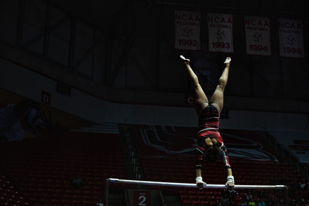 <p>Graduate student Jordyn Penny spins on the high bar while performing against Western Michigan Feb. 3, 2019, at Worthen Arena. The Ball State women's gymnastics team hosted West Michigan Feb. 3, 2019, at Worthen Arena. Ball State defeated the Broncos 194 - 193. <strong>Madeline Grosh,DN</strong></p>