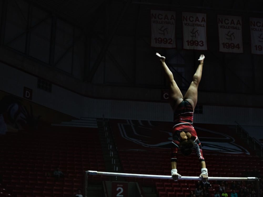Graduate student Jordyn Penny spins on the high bar while performing against Western Michigan Feb. 3, 2019, at Worthen Arena. The Ball State women's gymnastics team hosted West Michigan Feb. 3, 2019, at Worthen Arena. Ball State defeated the Broncos 194 - 193. Madeline Grosh,DN