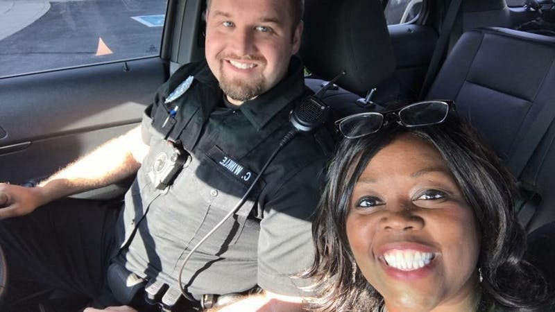 Muncie Police Department officer Chase Winkle selfies with Jeannine Lee Lake, editor and publisher of The Good News, during his first community ride along. Photo Courtesy