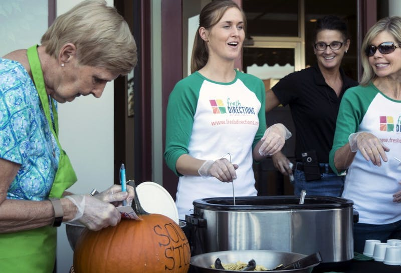 Fresh Directions, a local business, serves a Tomato Basil soup during the Soup Crawl on Oct. 5 in downtown Muncie. Their soup came with fresh mozerella balls. Rachel Ellis, DN