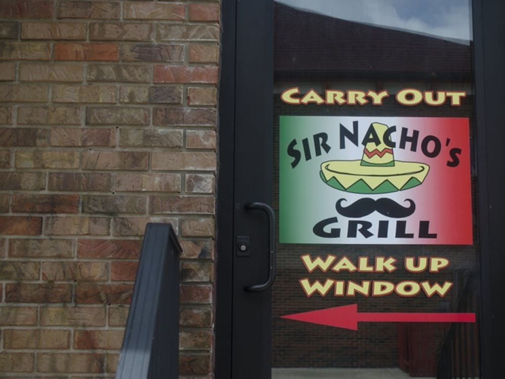 Sir Nacho's Grill is located in Cleo's Bourbon Bar in The Village. Sir Nacho's will soon take over Cleo's to become Three Amigos where the owners hope to sell to-go margaritas. DN FILE PHOTO BREANNA DAUGHERTY