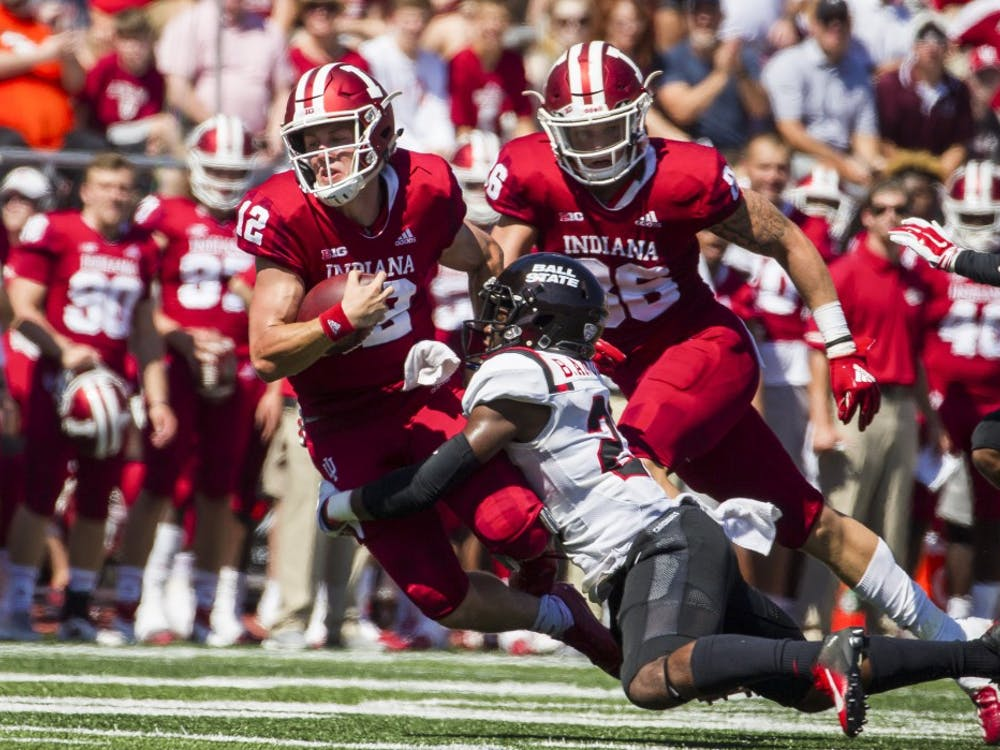 Junior quarter back Peyton Ramsey rushed for a first down and tackled sophomore safety Brett Anderson II Saturday, September 15, at Memorial Stadium, in Bloomington, IN. Ramsey passed 173 yards for IU, helping defeat Ball State, 10-38. Grace Hollars, DN