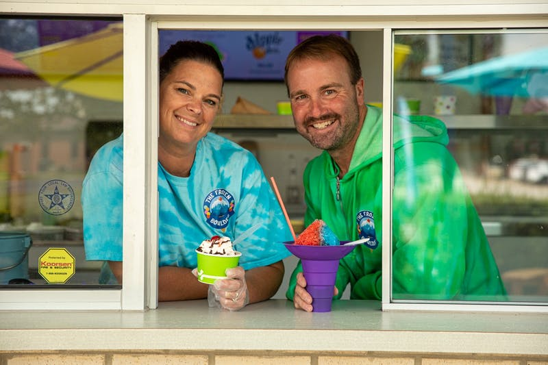 Kyla and Dave Bartle pose with frozen treats from their ice cream shop, The Frozen Boulder, Aug. 26, 2020. They thought of the name for their shop from the mini-golf course they own across the parking lot named, Boulder Falls. Jacob Musselman, DN Illustration