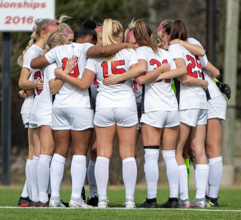 The Ball State Soccer team huddles up before the game March 12, 2021, at Briner Sports Complex. The Cardinals tied at zero in double overtime against the Broncos. Jaden Whiteman, DN