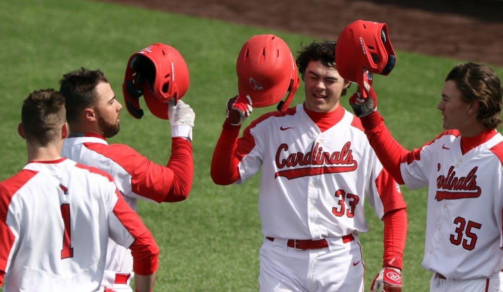 <p>Ball State junior center fielder Aaron Simpson, left, senior first baseman John Ricotta, freshman designated hitter Andre Orselli, and freshman left fielder Mack Murphy celebrate Ricotta's home run in the first during the Cardinals' game against Purdue March 19, 2019 at Ball Diamond at First Merchants Ballpark Complex in Muncie. Ricotta's home run put the Cardinals up 3-0. <strong>Paige Grider, DN</strong>&nbsp;</p>