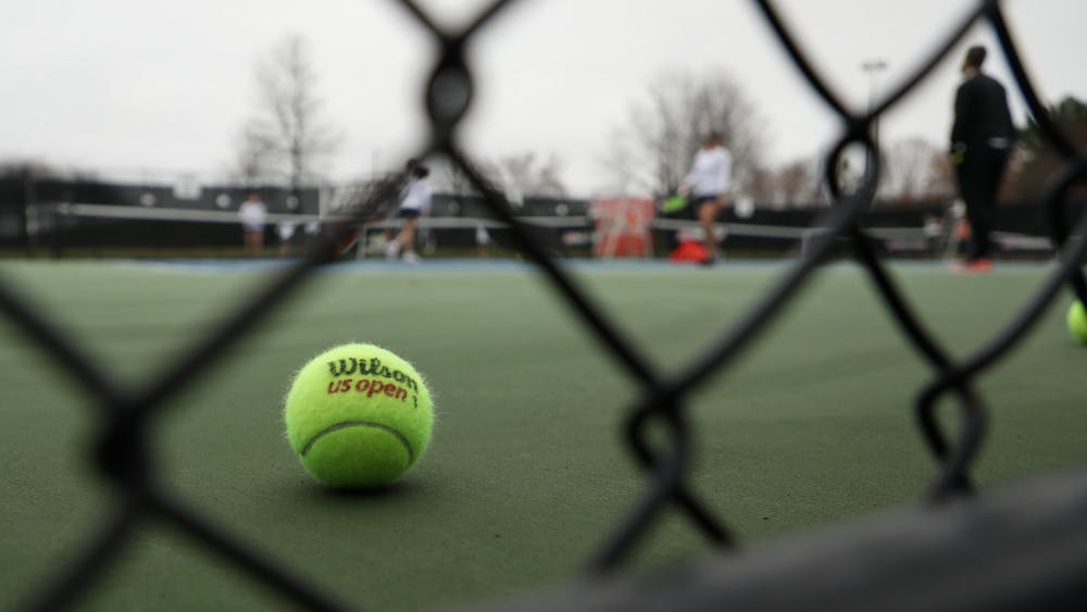 A stray ball sits on the court during a match March 26, 2021, in the Cardinal Creek Tennis Center. The Cardinals won 4-3 against the Falcons. Rylan Capper, DN