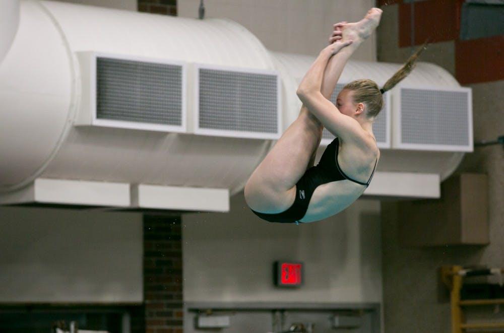 Junior Rachel Bertram dives during the meet against Grand Valley State on Nov. 18,2017, in Lewellen Pool. The Cardinals won the meet, 164-136. Kaiti Sullivan, DN