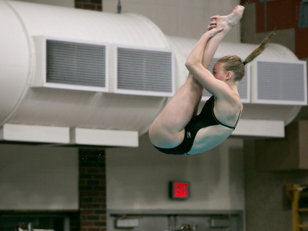 Junior Rachel Bertram dives during the meet against Grand Valley State on Nov. 18,2017, in Lewellen Pool. The Cardinals won the meet, 164-136. Kaiti Sullivan, DN