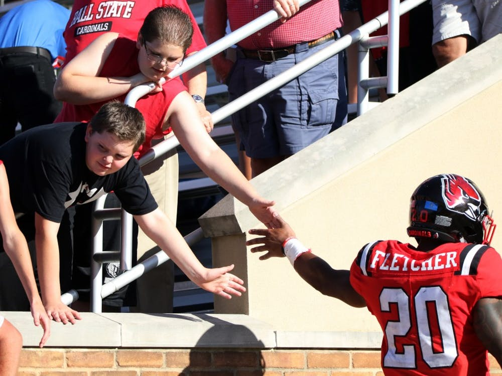 Ball State fans high five graduate student running back Walter Fletcher after the Cardinals' game against Florida Atlantic Saturday, Sept. 14, 2019, at Scheumann Stadium. Ball State lost, 31-41. Paige Grider, DN