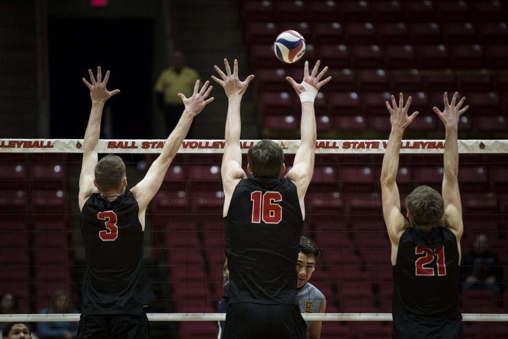 <p>Freshman outside attacker Ben Chinnici, senior middle attacker Matt Walsh and sophomore setter Courtland Scharenborg, reaches to block a Emmanuel Lions attacker, Jan. 6, at John E. Worthen Arena. Ball State swept the Lions, in three straight sets, 16-25, 15-25, 12-25. <strong>Grace Hollars, DN</strong>&nbsp;</p>