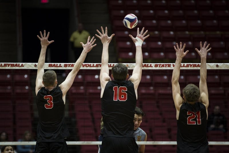 Freshman outside attacker Ben Chinnici, senior middle attacker Matt Walsh and sophomore setter Courtland Scharenborg, reaches to block a Emmanuel Lions attacker, Jan. 6, at John E. Worthen Arena. Ball State swept the Lions, in three straight sets, 16-25, 15-25, 12-25. Grace Hollars, DN