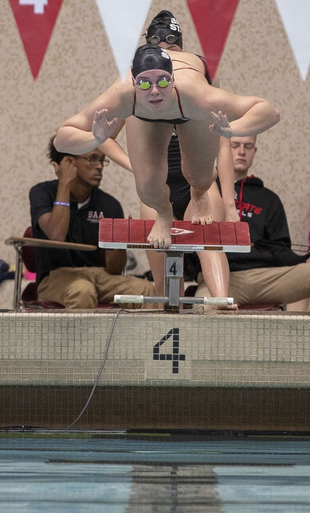 A Ball State swimmer launches off the starting block at the women's swim meet Saturday Nov. 3, at Lewellen Aquatic Center. The Cardinals competed against the University of Akron. Jacob Haberstroh,DN.
