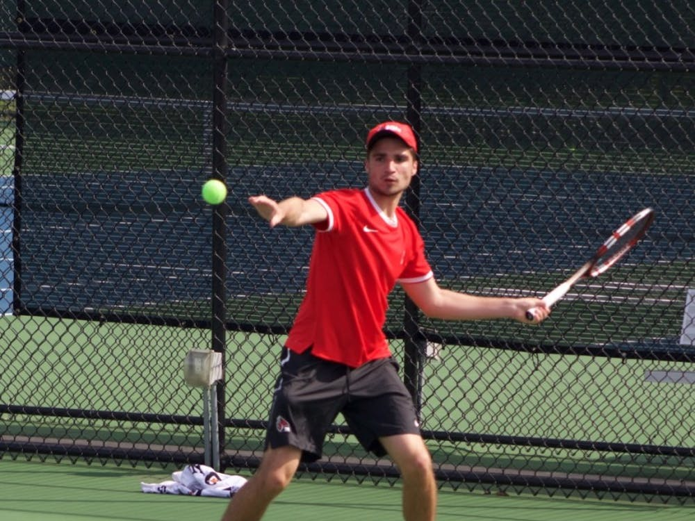 Junior Marko Guzina attempts to hit a ball back against IUPUI on April 12 at Cardinal Creek Tennis Center. Guzina lead late in the second set by 4-3. Patrick Murphy, DN File