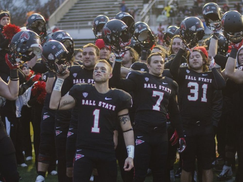 The Ball State football team sings the fight song after the game against Eastern Michigan on Nov. 22 at Scheumann Stadium. Ball State won 45-30. DN PHOTO BREANNA DAUGHERTY