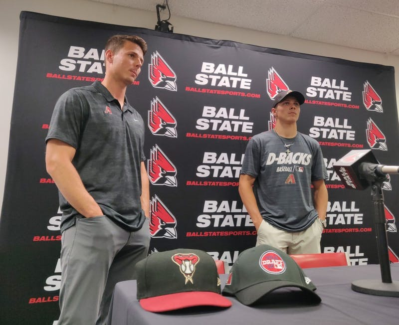 Jeremy Kehrt, Arizona Diamondbacks recruiter, and Drey Jameson, sophomore outfielder and pitcher, converse after a press conference June 7, 2019, at Worthen Arena. Jameson is the eighth first-round draft pick in Ball State Baseball's history. Rohith Rao, DN