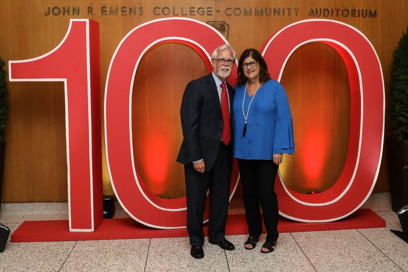 """Indiana Senator Timothy S. Lanane and his wife Cindy stand infront of Ball State's 100 sign celebrating a century of being open Thursday, Sept. 6, 2018, at Emens Auditorium. The documentary """"From Normal to Extraordinary: Ball State's First Century,"""" premiered at the event. Rebecca Slezak,DN"""