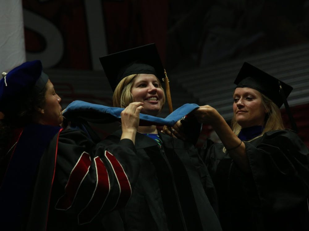 A student receives her doctoral hood at the summer commencement ceremony July 20, 2019, at Worthen Arena. Rohith Rao, DN