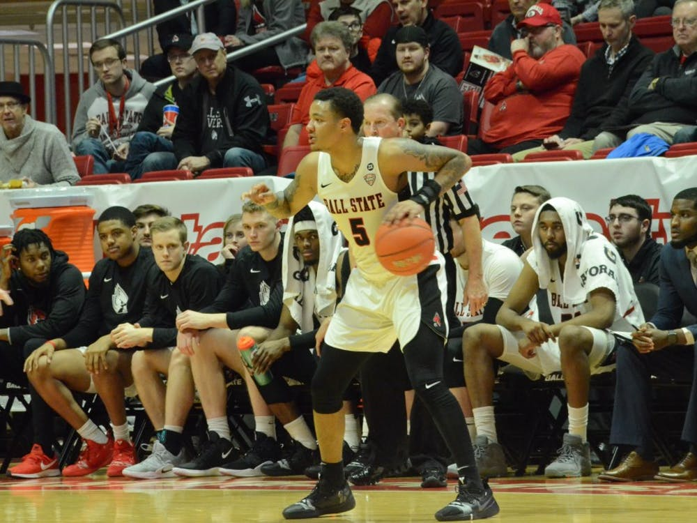 Sophomore guard Ishmael El-Amin looks for an open teammate during a game against Toledo on Feb. 27 at Worthen Arena. The Cardinals lost 80-72. Jack Williams, DN