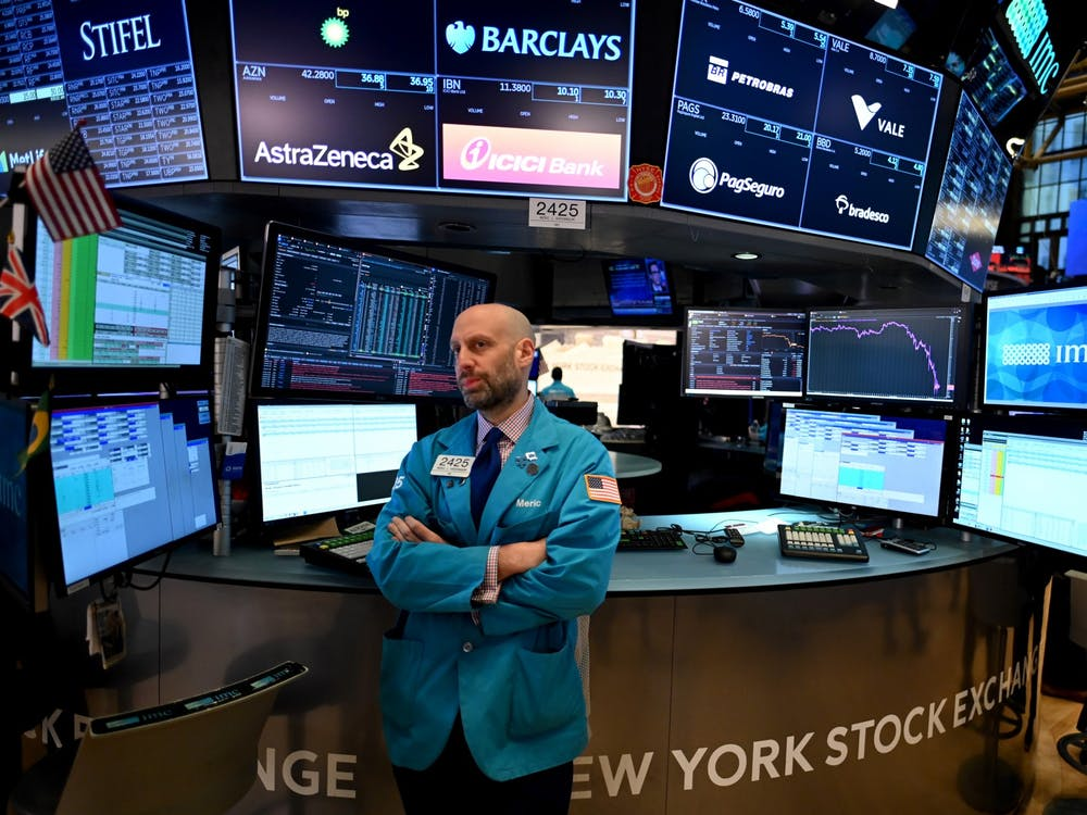 Traders work during the opening bell at the New York Stock Exchange (NYSE) on March 16, 2020 at Wall Street in New York City. (Johannes Eisele/AFP/Getty Images/TNS)