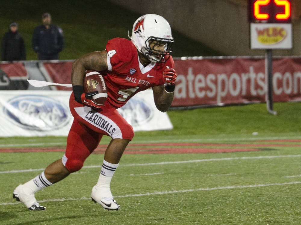 Junior running back Horactio Banks runs the ball down the field against Central Michigan on Nov. 6 at Scheumann Stadium. Banks is expected to recover from injury by the end of the summer. DN FILE PHOTO BREANNA DAUGHERTY