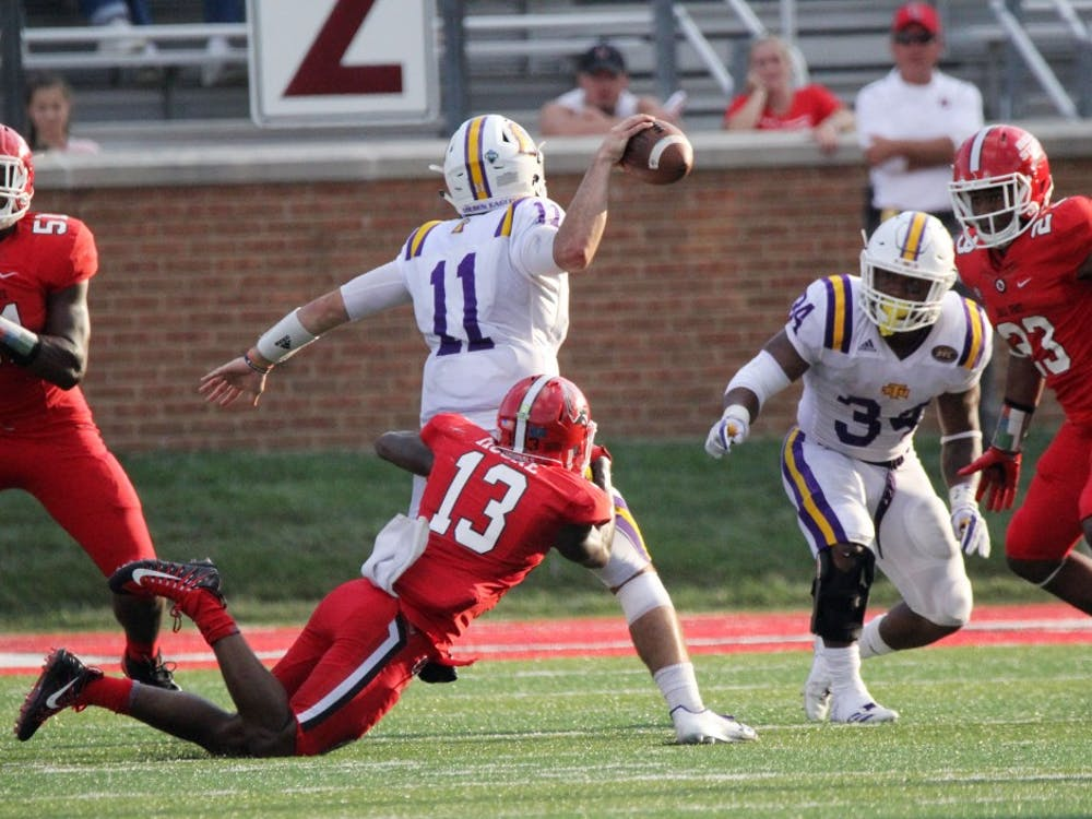 Ball State redshirt senior cornerback David Moore sacks Tennessee Tech's Andre Sale in the fourth quarter of the Cardinals' 28-13 win against the Golden Eagles on Sept. 16 at Scheumann Stadium. Moore had three solo tackles. Paige Grider, DN