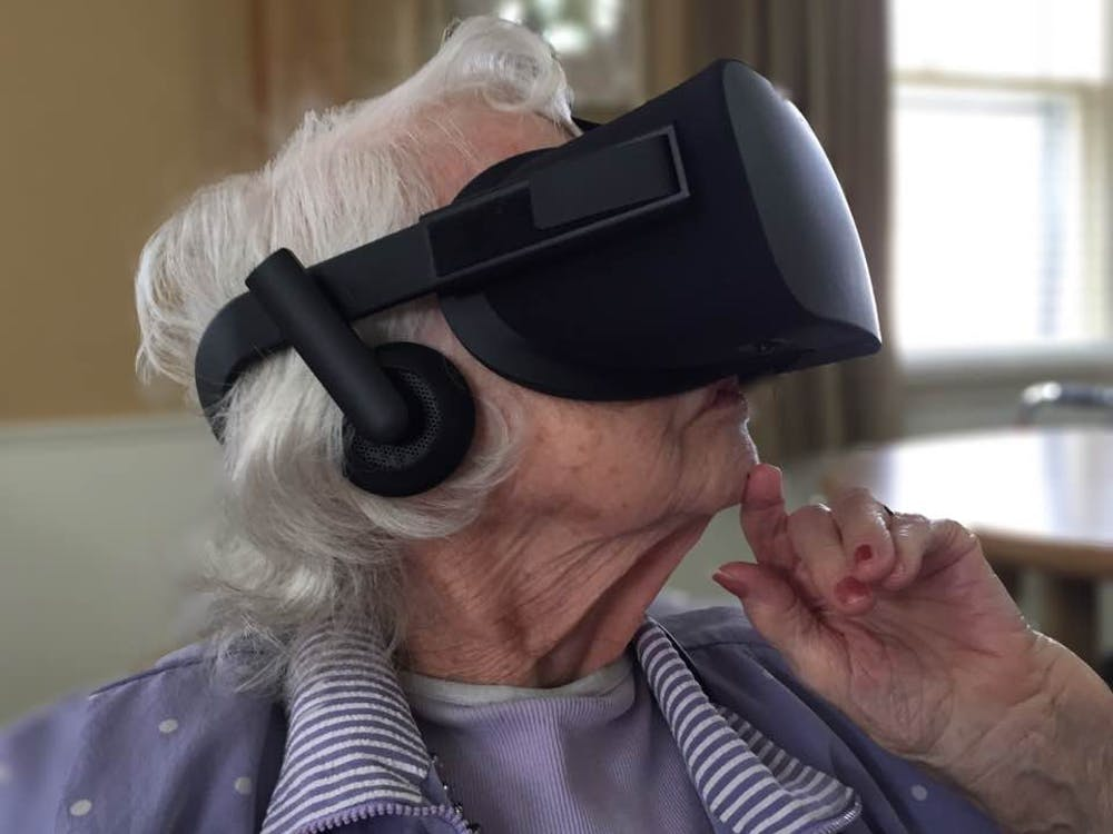 A nursing home resident tries virtual reality. // Photo provided by Mike Gerhard.