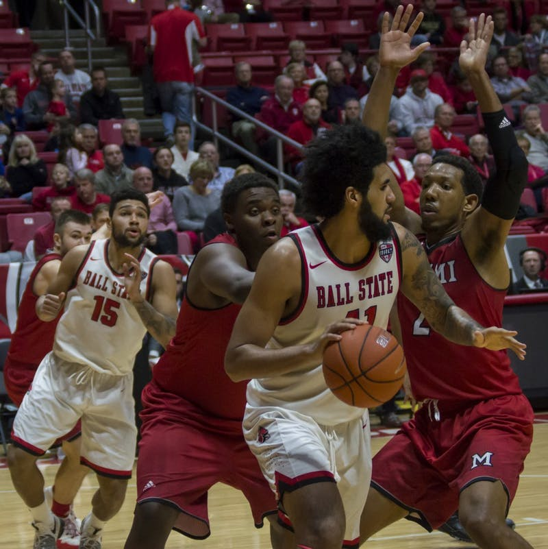Ball State center Trey Moses attempts to pass the ball during the game against Miami on Jan. 10 in Worthen Arena. The men's basketball team won 85-74. Terence K. Lightning Jr. // DN