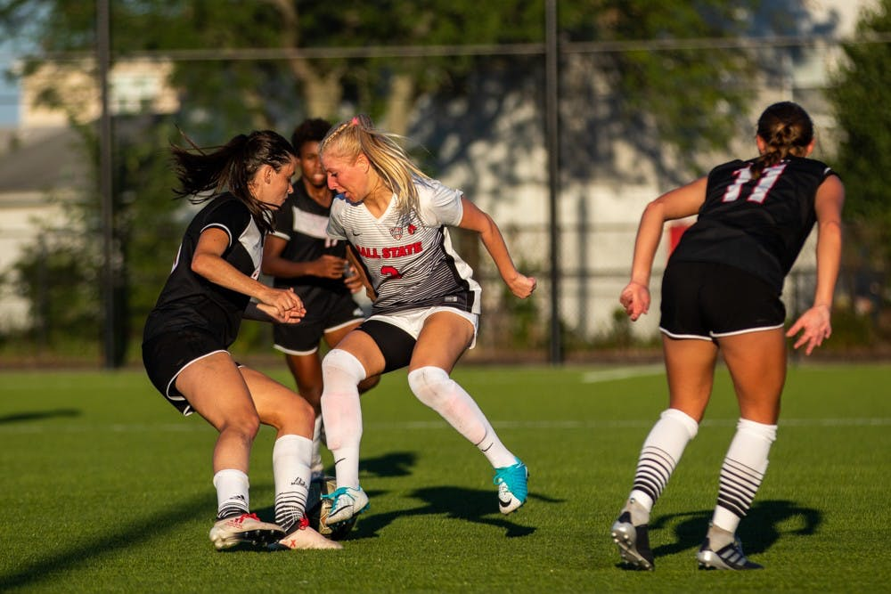 Midfielder/forward Amanda Shaw attempts to fight past three players from the University of Nebraska-Omaha in the final drive before time expired Friday, Sept. 14, 2018 at Briner Sports Complex. The Cardinals defeated Omaha 3 to 1 with all goals being scored in the second half of the game. Eric Pritchett,DN