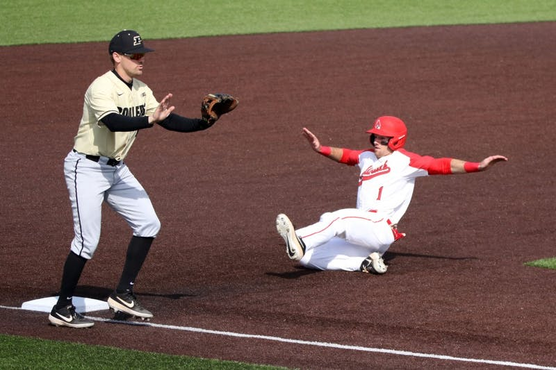 Purdue senior third baseman Nick Evarts calls off junior catcher Bryce Bonner as junior center fielder Aaron Simpson steals third during the Boilermakers' game against Ball State March 19, 2019 at Ball Diamond at First Merchants Ballpark Complex in Muncie, IN. Ball State's 6 to 0 win over Purdue gives them a 11-9 record. Paige Grider, DN