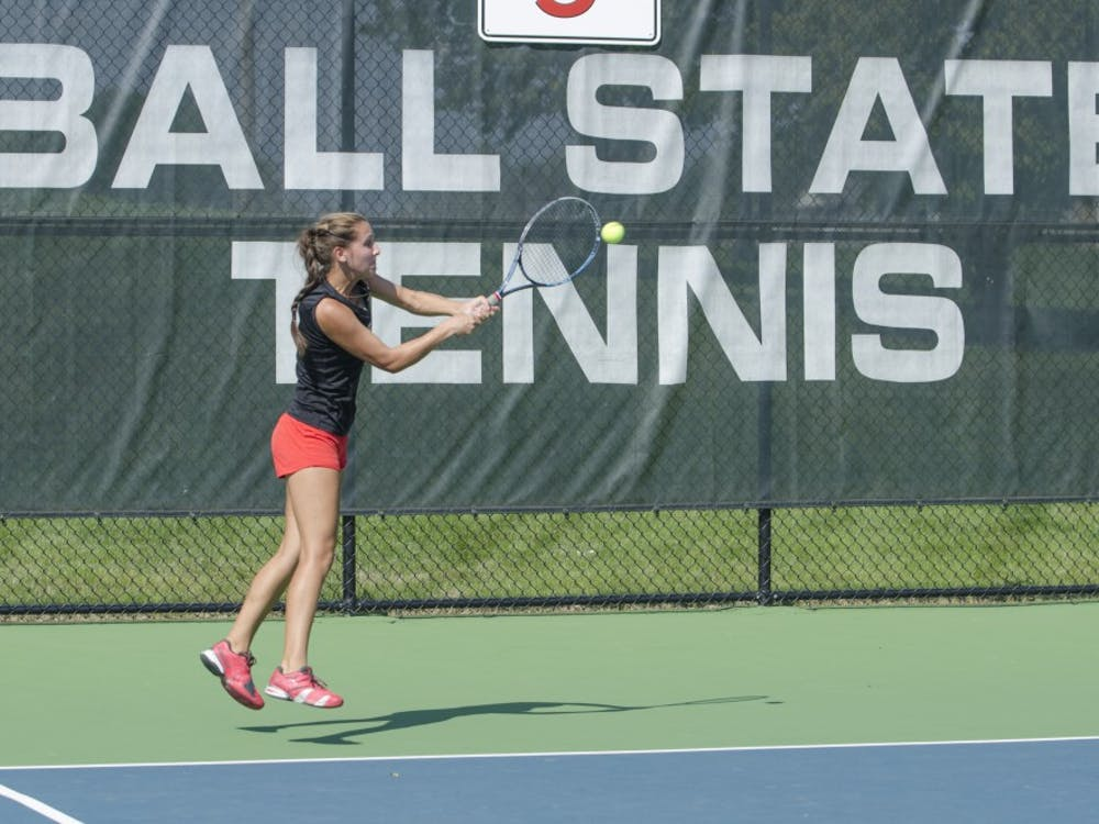 Sophomore Toni Ormond hits the ball during the doubles match against Butler for the Fall Dual on Sept. 20 at the Cardinal Creek Tennis Center. DN PHOTO BREANNA DAUGHERTY