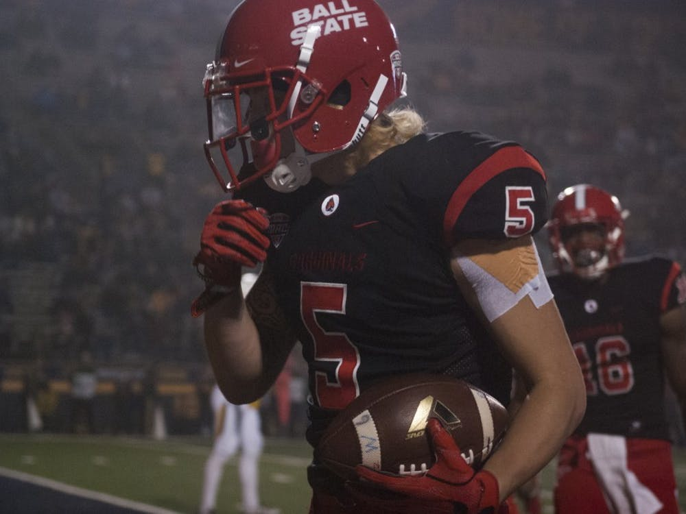 Junior receiver Corey Lacanaria celebrates after scoring a touchdown in Ball State's 37-19 loss to Toledo at the Gall Bowl Wednesday, Nov. 16. With the loss, the Cardinals were officially eliminated from Bowl contention. Colin Grylls//DN
