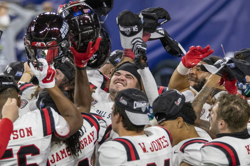 Multiple Ball State Cardinals sing the Ball State fight song after beating the University at Buffalo 38-28 in the Mid American Conference Championship Dec. 18, 2020, at Ford Field in Detroit, Mich. Jacob Musselman, DN