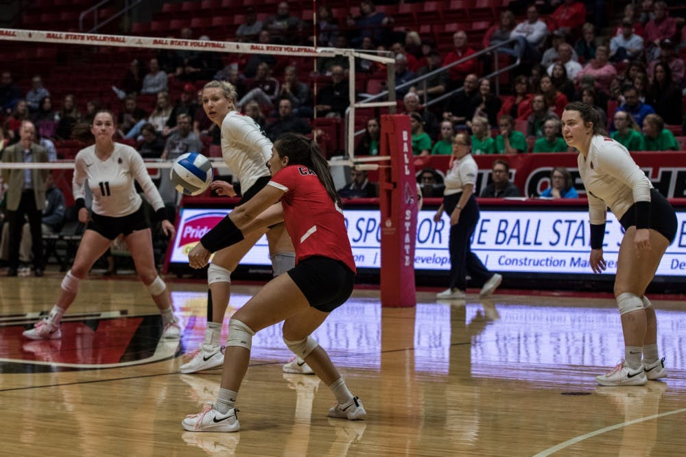 Everyone in John E. Worthen Arena looks on Kate Avila Oct. 12, 2018, as she attempts to return a ball served by Ohio University in the fourth set of the game. The Cardinals couldn't close out the third set, but brought it back in the fourth to defeat the Bobcats. Eric Pritchett,DN