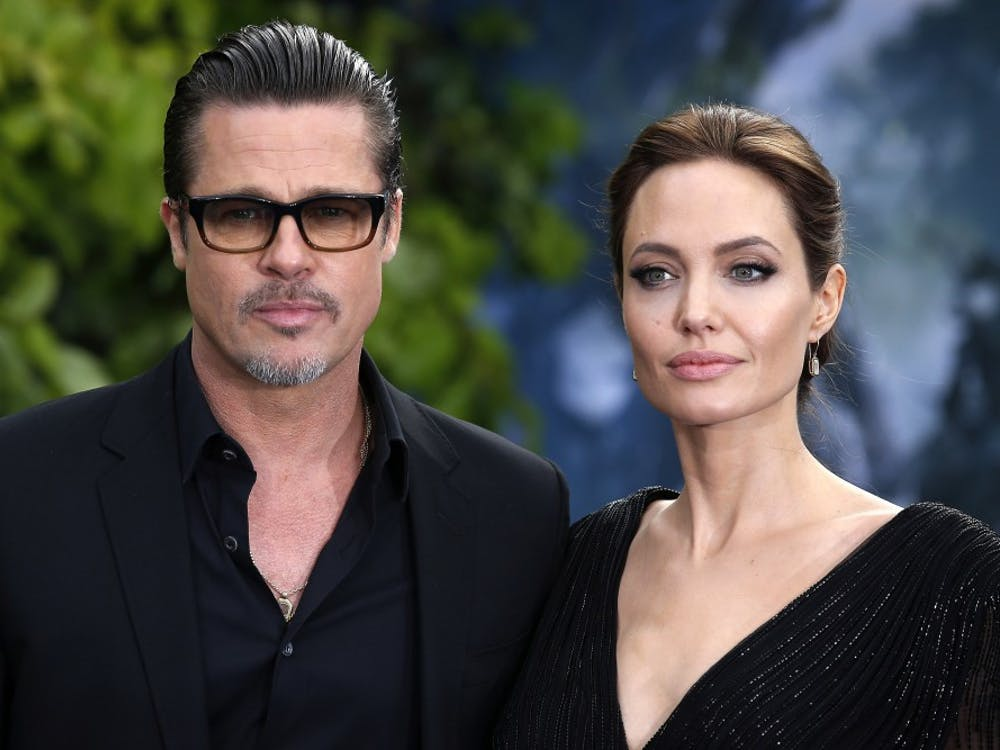 In this file image from 2014, Brad Pitt and his wife Angelina Jolie attend the premiere of Maleficent at Kensington Palace, London. Jolie has filed for divorce, TMZ reported on Sept. 20, 2016. (Justin Tallis/PA Wire/Zuma Press/TNS)